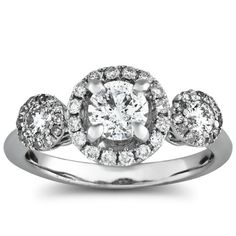This unique 3-stone ring features a .62 carat round center diamond and .55 carat total weight side diamonds, prong set in 14k white gold.