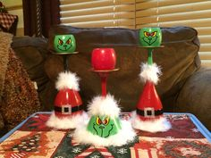 Grinch wine glass candle holders.
