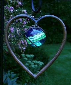 Heart sun catcher for the yard - hang from a standing hook above  your flowers
