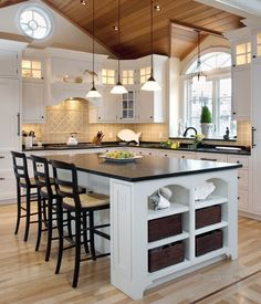 Gorgeous beach house kitchen- but with white granite and light wood stools