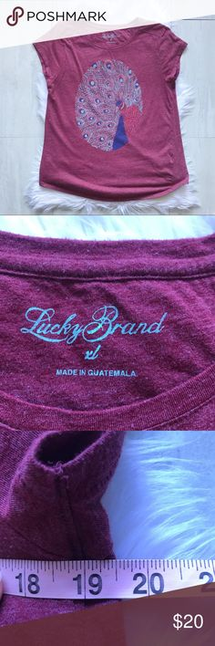 """Lucky Brand Peacock Graphic Tee Size Extra Large Gorgeous graphic tee by Lucky Brand. Short sleeve top in a heathered burgundy color with peacock graphic on the front.   Laying flat, bust measures 19.5"""" and length is 27.5"""". EUC from a smoke free home!  ⭐️no trades⭐️ ⭐️I'm open to offers and I ALWAYS send a counteroffer⭐️ Lucky Brand Tops Tees - Short Sleeve"""