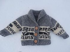 Super adorable, Cowichan inspired toddler sweater.  Uses Briggs and Little's  Country Roving, 4 wheels in 3 colours . One size only free pattern.