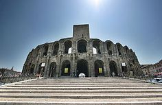 The Arles Amphitheatre (French: Arènes d'Arles) is a Roman amphitheatre in the southern French town of Arles. This two-tiered Roman amphitheatre is probably the most prominent tourist attraction in the city of Arles, which thrived in Roman times.