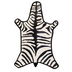 Cruelty Free:  A zebra rug even a zebra would admire, made of hand loomed llama wool by Jonathan Adler. 5'x7', $995.