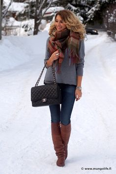 grey sweater, dark skinny jeans, love the way she brought in the whiskey of her boots with a big, plaid scarf!---looks so cozy