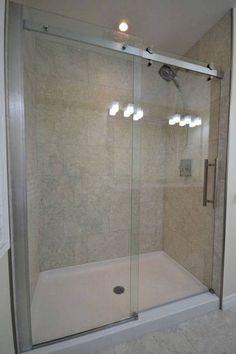 shower pan with sliding glass door in bathroom