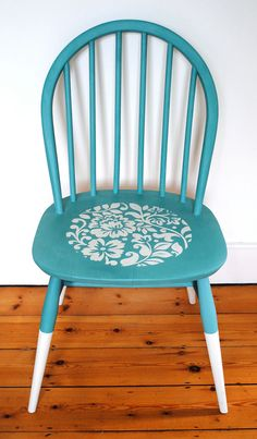 An upcycled Danish wooden chair with an Ercol sticker on the back. It has been painted and stencilled using the finest quality Annie Sloan chalk paint and finished with a couple of coats of clear wax. The stencil is an original design which I hand cut. The legs have a dipped effect Any imperfections should be seen as part of the charm of this one-off original piece. Colours: Provence and Old White Dimensions: height 82cms width: 42.5cms depth: 41cms Shipping rates available upon...