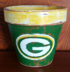 Check out this item in my Etsy shop https://www.etsy.com/listing/252532094/hand-painted-terracotta-pot-green-bay