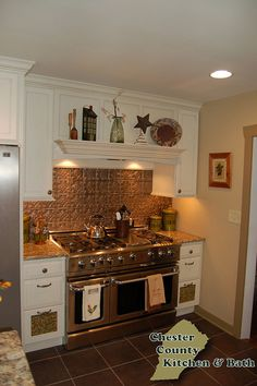 These ledges are growing on me. I like the whole stove and cabinet set up. Stratford-Ivory-Cream by Chester County Kitchen & Bath, via Flickr