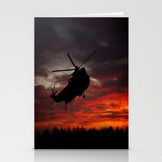 Set of folded stationery cards printed on bright white, smooth card stock to bring your personal artistic style to everyday correspondence. Each card is blank on the inside and includes a soft white, European fold envelope for mailing. ABOUT THE ART  Silhouette of the RAF Search and Rescue helicopter at Sunrise.