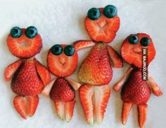Fun food art with strawberries and blueberries.