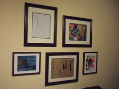 Gallery wall.  Frames from Goodwill filled with my children's art.