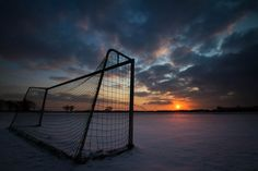 Winter snow sunset on empty soccer goal. Beautiful wide angle!  Other Soccer scratchings at: www.zazzle.com/SoccerMomCity?rf=238479042766184488 and http://www.cafepress.com/SoccerMomCity?aid=78178956