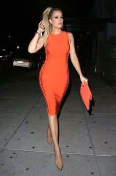 Khloe Kardashian Khloe Kardashian's found herself a guy who's quite the gentleman. Khloe and rumored boyfriend Tristan Thompson flaunted the sweetest PDA possible as they walked to their hotel in Cabo S… Khloe Kardashian Outfits, Kylie Jenner Outfits, Koko Kardashian, Kardashian Jenner, Tristan Thompson And Khloe, Khloe Kardashian Tristan Thompson, Orange Dress, The Dress, Nice Dresses