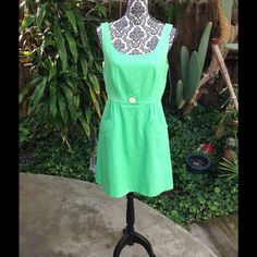 Exciting Cynthia Rowley! Beautiful lime green Cynthia Rowley dress with floral button, side pockets and zippers back. Cynthia Rowley Dresses Mini