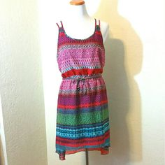 Colorful Chiffon High Low Dress Colorful Chiffon High Low Dress. Fully lined. Dual spaghetti straps, racer back, elastic waist. Leather (faux) braided belt. EUC.  No Trade or PP  Offers Considered  Bundle discounts Speechless Dresses High Low