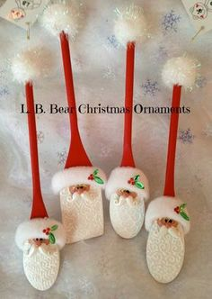 L. B. Bear Christmas Ornaments - wooden spoons hand painted and embellished Santa ornaments - each has a different design on the beard! I'm sure charity shops would have some old wooden spoons to buy cheaply and make some of these!