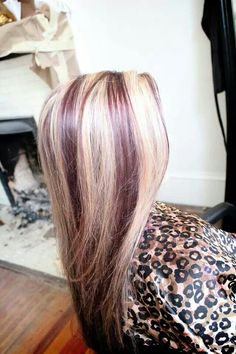 Violet red lowlights with blonde highlights might try this with a shadow under