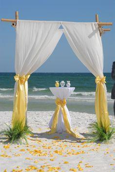 Barefoot bamboo beach wedding arbor with unity sand table