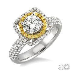 Love this yellow diamond halo! www.sturhahnjewelers.com #WhenTheMomentMatters
