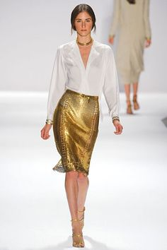Elie Tahari Spring 2012 collection. Gold chain-maille skirt looks demure when paired with a simple tailored silk ivory blouse.