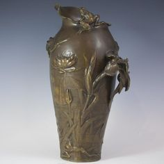 "An Art Nouveau bronze jug from the Susse Foundry. Features embossed floral and reeded designs along with dragonflies, frogs, cranes and a plant stem side handle. Marked: ""F. Debon, Susse Fs. Edt., Susse Freres Editeurs Paris"" CIRCA:Early 20th Ct. ORIGIN:France DIMENSIONS:H:11.75"" L:7.5"" W:5"""