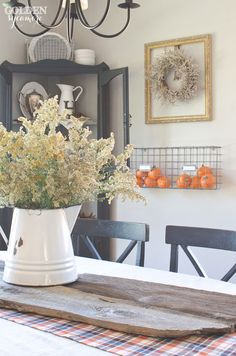 Centerpiece with pitcher of weeds on barnwood | Dining room Home Tour from The Golden Sycamore