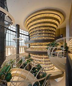 HMA forms M. bookstore around a massive circular bookcase in china Architecture Design, China Architecture, Shopping Mall Interior, Retail Interior, In China, Atrium Design, Archi Design, Library Lighting, Harbin