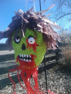 Zombie piñata (piñata pictured has been sold, the one you receive will be made to order)    Who wouldnt love to take a swing at a zombie