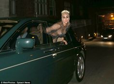 Feeling the breeze: The singer gave onlookers quite an eyeful in her mesh dress as she leaned over