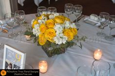 Square clear vase of full flowers centerpieces