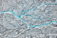 Picture of meltwater flowing across the top of the Greenland ice sheet