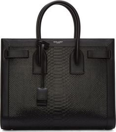 Structured python leather tote bag in black. Silver-tone hardware. Rolled carry handles at top. Logo embossed at bag face trim in silver. Accordion-fold gussets expandable by straps with snap-button fastenings at front and back faces. Adjustable, removable shoulder strap. Padlock charm encased in tonal leather envelope compartment affixed at top handle. Round bumper studs at reinforced base. Two-way zippered pouch at center of bag interior compartment. Zip and patch pockets at bag interior…