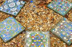 I have made oodles of these stepping stones with my daughter. A quick fun and easy mosaic craft to do with kids or alone. We used glass pieces which you can find at dollar stores, mosaic tiles and lots of shells we picked up at the beach!
