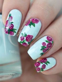 Baby blue nails with roses