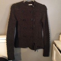Knit sweater/jacket Dark gray Has some minor flaws like small random strings pulled and fuzz but overall is great... Has fake buttons and a zipper with pockets on each side is a Dark gray shade and is somewat hole -y as in a knit sweater would be SIZE is medium in women's Charlotte Russe Sweaters