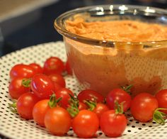 Roasted Tomato  Hummus  4 garlic cloves  1 teaspoon salt  Two 1-pound 3-ounce cans chick-peas, drained and rinsed  2/3 cup well stirred tahini  1/4 cup fresh lemon juice, or to taste  1/2 cup olive oil, or to taste  1/2-1 cup roasted tomato