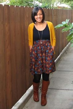 Midi skirts & cardigans make for the best teacher fashion. Bold colors compliment the darker tones.  Love!