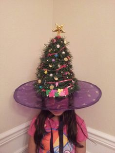 Crazy Christmas tree hat for crazy hat day at school made with an old witch hat and garland.