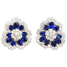 Van Cleef & Arpels Sapphire Diamond Platinum Camellia Earclips | From a unique collection of vintage clip-on earrings at https://www.1stdibs.com/jewelry/earrings/clip-on-earrings/
