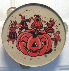 vintage halloween noisemaker tambourine with costumed children and a jack o lantern