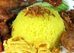 Yellow rice dish when not served in cone shape is called Nasi Kuning. There are many regions serve different taste inspite of tumeric/curcumin as primary ingredient, e.g. in Banjar, it is rather oily mixed with fermented soy bean and fried Harwan (Channa Striata) or, in Manado, it is mixed with ground beef, or in Lombok, it is very spicy.