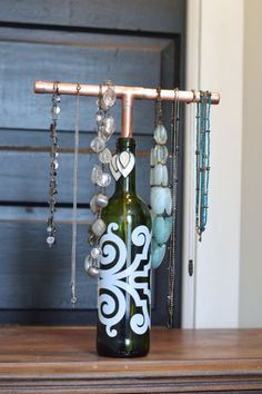 newlywoodwards shows us how to make an upcycled wine bottle jewelry display Jewellery Storage, Jewelry Organization, Jewellery Display, Diy Jewellery, Jewellery Stand, Diy Necklace Display, Jewellery Making, Fashion Jewelry, Jewellery Shops