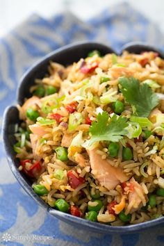 Have leftover rice and cooked salmon? Make salmon fried rice! Comes together in minutes. Easy and so good! #1pot On SimplyRecipes.com