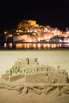 The Knights Templar built the castle in the town of Peñiscola between the years 1294 and 1307. Some eight centuries later, it often serves as a handy model for those who like to build sand castles on Peñiscola's stunning beach. Photo ©Mike Randolph