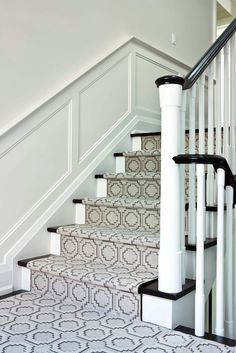 Jennifer Worts Design - Second floor landing with wainscoting and geometric pattern stair runner.