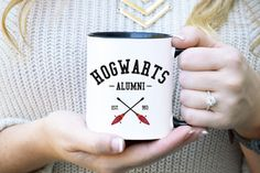 Break out your Marauders Map and wand! This Harry Potter themed mug displays a badge that reads, Hogwarts Alumni. As you sit down to read the new Harry Potter book have your coffee along side in this cute Hogwarts mug.  *** PLEASE NOTE *** The 15 oz White & Black mug is not available to order and will return as soon as possible. Currently all mugs are a 3-4 business day turnaround time to be shipment ready. However, a 1 day rush is available. To purchase a rush, link is located at the bottom…