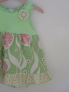 Take tank tops that have gotten too small, add a fabric skirt, and you have an adorable little girl dress. You can also get these tanks for nothing at consignment.