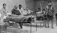 British soldier guards injured republican prisoners in a temporary hospital at Dublin Castle after the Easter Rising of Republican News, Irish Republican Army, Ireland 1916, Dublin Ireland, British Soldier, British Army, Easter Rising, Dublin Castle, Michael Collins