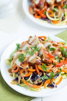 Thai Chicken Noodles are a delicious meal that the entire family with love. Zucchini noodles, carrot noodles, cabbage, and red bell pepper are cooked and served with soy-ginger chicken and peanut dressing!